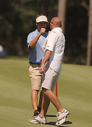 Defending Michigan Amateur Champion Christian Vozza of Traverse City celbrates with his caddie after making a long putt on the 8th hole of the Heather course at Boyne Highlands.