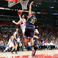 25 March 2016: LA Clippers guard Austin Rivers (25) goes for the lay past Utah Jazz center Boris Diaw (33) during the Los Angeles Clippers 108-95 victory over the Utah Jazz, at the Staples Center, Los Angeles, California, USA.