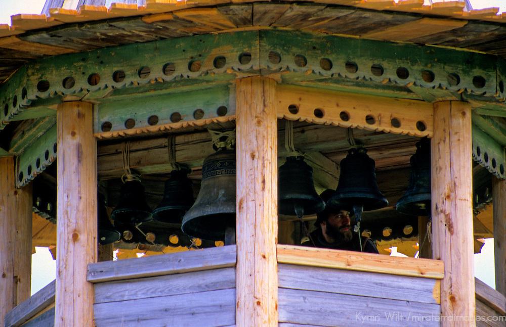 Europe, Russia, Kizhi Island. Bell ringer in bell tower.