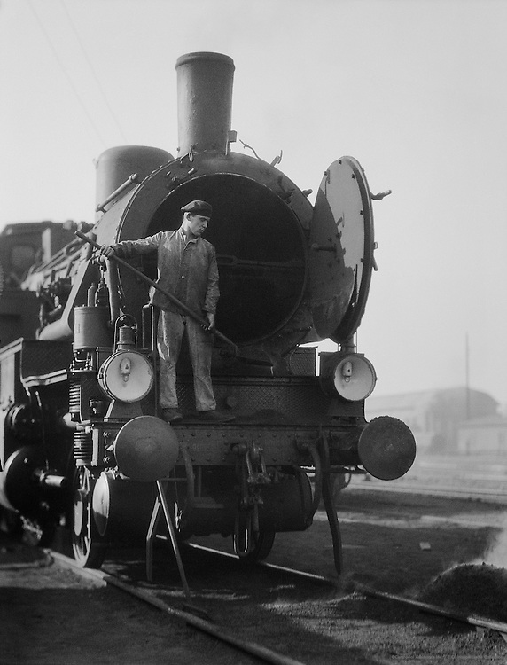 Railroad Worker Cleaning Boiler of Type 38 Locomotive, Anhalter Bahnhof, Berlin, 1925