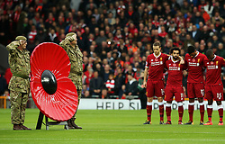 Liverpool players take part in a minutes silence ahead of soldiers with a remembrance poppy - Mandatory by-line: Matt McNulty/JMP - 28/10/2017 - FOOTBALL - Anfield - Liverpool, England - Liverpool v Huddersfield Town - Premier League