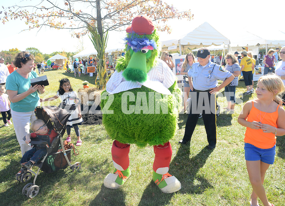 WARRINGTON, PA - SEPTEMBER 27: The Phillies Phanatic dances with a crowd during Warrington Community Day September 27, 2014 at John Paul Park at Lower Nike in Warrington, Pennsylvania. (Photo by William Thomas Cain/Cain Images)