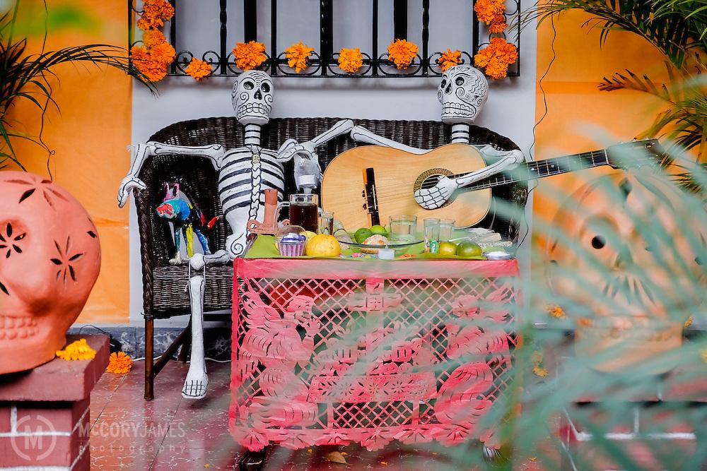 An altar on a porch for Dia de los Muertos