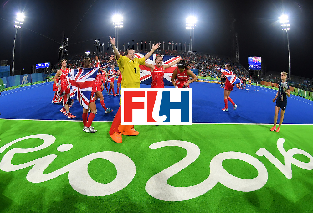 Britain's players celebrate their victory at the end of the women's Gold medal hockey Netherlands vs Britain match of the Rio 2016 Olympics Games at the Olympic Hockey Centre in Rio de Janeiro on August 19, 2016. / AFP / MANAN VATSYAYANA        (Photo credit should read MANAN VATSYAYANA/AFP/Getty Images)