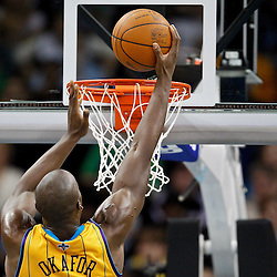 January 22, 2011; New Orleans, LA, USA; New Orleans Hornets center Emeka Okafor (50) goes up for a dunk against the San Antonio Spurs during the fourth quarter at the New Orleans Arena. The Hornets defeated the Spurs 96-72.  Mandatory Credit: Derick E. Hingle