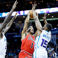 03 November 2015: Chicago Bulls guard Derrick Rose (1) goes for the layup against Charlotte Hornets guard Kemba Walker (15) during the Charlotte Hornets  130-105 victory over the Chicago Bulls, at the Time Warner Cable Arena, in Charlotte, North Carolina, USA.