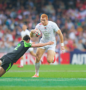 James Rodwell breaks a tackle during the Hong Kong Sevens 2015 match between England and Wales at Hong Kong Stadium, Hong Kong on 27 March 2015. Photo by Ian Muir....during the Hong Kong Sevens 2015 match between ........... at Hong Kong Stadium, Hong Kong on 27 March 2015. Photo by Ian Muir.