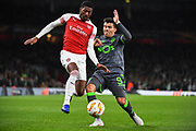Arsenal Midfielder Ainsley Maitland-Niles (15) and Sporting Lisbon Forward Marcos Acuna (9) battle for the ball during the Europa League group stage match between Arsenal and Sporting Lisbon at the Emirates Stadium, London, England on 8 November 2018.