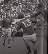 Action from the 1973 Munster final between Limerick and Tipperary. Eamon Cregan watches as Frankie Nolan (13) gets an early goal, with Ned Rea in attendance. The switch of Cregan to centreback for the  final with Kilkenny was vital in Limerick winning their seventh title.