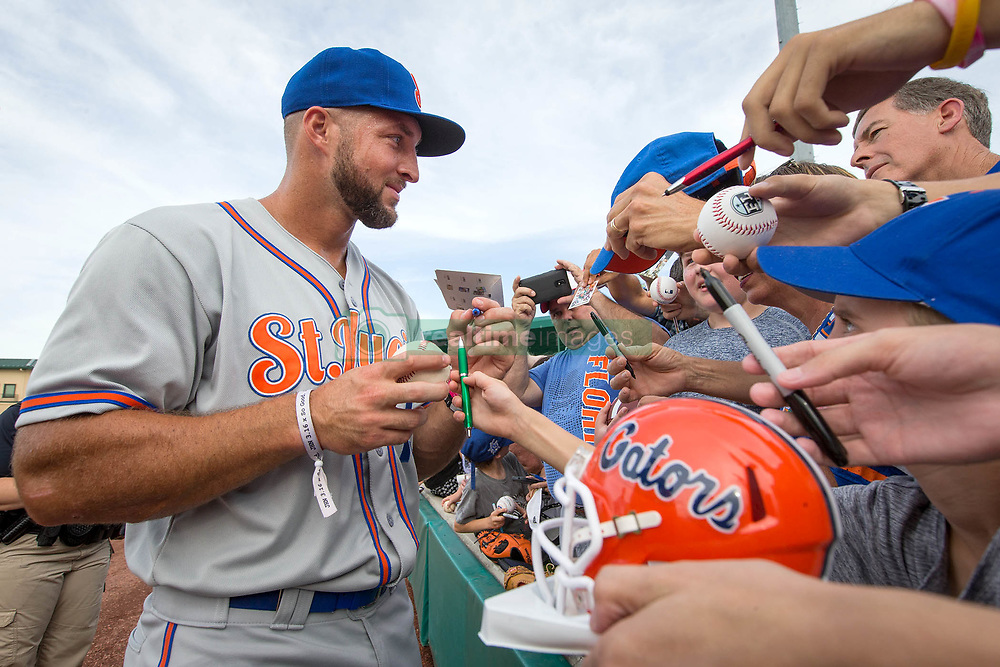 July 7, 2017 - Jupiter, Florida, U.S. - St. Lucie Mets Tim Tebow signs autographs at Roger Dean Stadium in Jupiter, Florida on July 7, 2017. (Credit Image: © Allen Eyestone/The Palm Beach Post via ZUMA Wire)