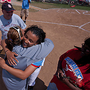 04/21/12 Dover Del. Delaware State Jordan Reid #12 hug her coach during a tribute to the Delaware State senior class prior to the start of a NCAA Softball game against Norfolk State Saturday, April. 21, 2012 at The Hornets Nest in Dover Del.<br />