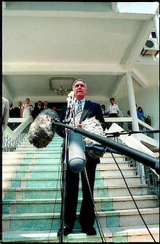 Arrival of Pete Peterson, first US Ambassador to Unified Vietnam. Tarmac stepping off US plane, Noi Boi Airport, Hanoi. 1997.