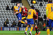 Morecambe Midfielder Kevin Ellison heads for goal during the Sky Bet League 2 match between Morecambe and Mansfield Town at the Globe Arena, Morecambe, England on 26 January 2016. Photo by Pete Burns.