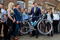 © Licensed to London News Pictures. 18/06/2014. LONDON, UK. The Deputy Prime Minister Nick Clegg inspects the Team Sky bicycle made for Tour De France with children from Bradfield School of Sheffield as he holds a reception ahead of the Grand Départ of the Tour de France, hosting organisers from the three UK stages of the Tour, businesses on the route, representatives of Team Sky and their sponsors, British bike manufacturers in Westminster, London on Wednesday, 18 June 2014. Photo credit : Tolga Akmen/LNP