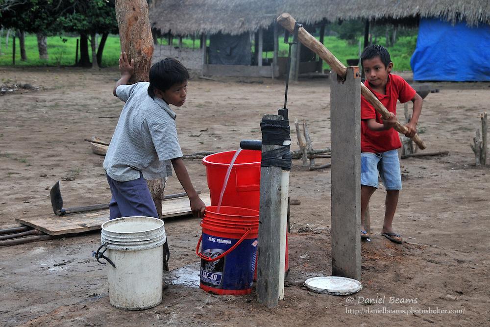 Yuracare children pumping water from a well in Villa Hermosa, near San Lorenzo, Beni, Bolivia