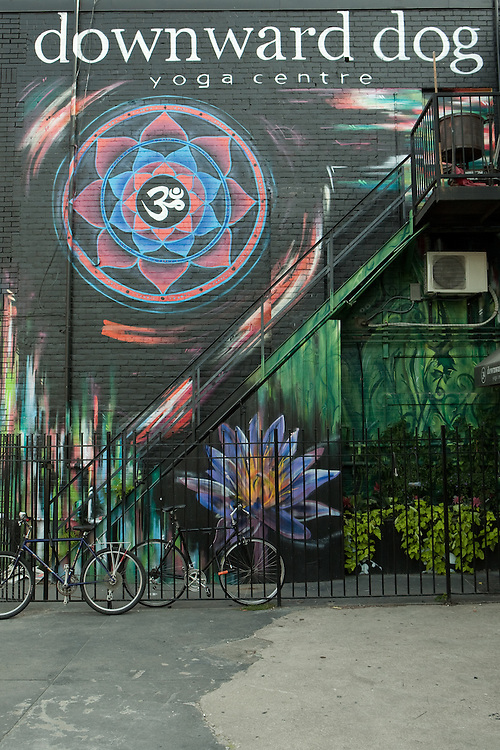 Colorful mural at the Downward Dog yoga studio in Toronto's trendy Queen Street West.