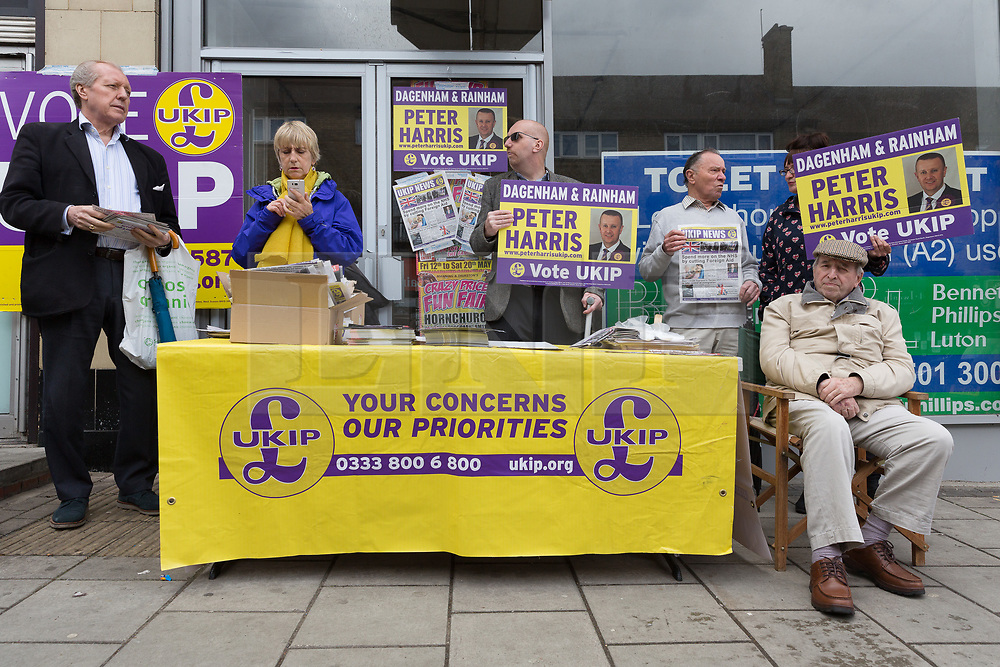 © Licensed to London News Pictures. 20/05/2017. LONDON, UK.  UKIP supporters on a stall in Elm Park as they await UKIP leader, Paul Nuttall and UKIP candidate for Dagenham and Rainham, Peter Harris. All political parties continue to campaign across the UK ahead of the general election taking place on 8th June. Photo credit: Vickie Flores/LNP