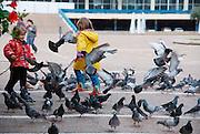 Israel, Tel Aviv, Kikar Rabin, Rabin square, children playing with pigeons