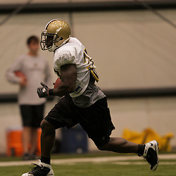10 August 2009: New Orleans Saints running back Lynell Hamilton (30) runs with the ball during New Orleans Saints training camp at the team's indoor practice facility in Metairie, Louisiana.