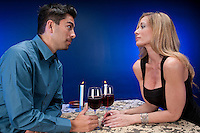 Couple chatting  friendly in restaurant or night club setting. Young hispanic boy in his 20s with adult woman in her 40s.