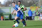 Forest Green Rovers midfielder Dan Wishart (17) closes down North Ferriby United midfielder Danny Emerton (6) 0-1 during the Vanarama National League match between Forest Green Rovers and North Ferriby United at the New Lawn, Forest Green, United Kingdom on 1 April 2017. Photo by Alan Franklin.