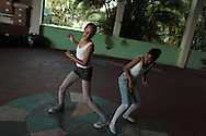 Girls joke with each other before their ballet class at the 'Ballet Santa Teresa' academy in Rio de Janeiro August 13, 2012. 'Ballet Santa Teresa', a non-governmental organization (NGO) gives children who live in areas with social risk, some suffering domestic violence, free ballet classes and other activities as a part of socio-cultural integration project.  Photo by: Pilar Olivares