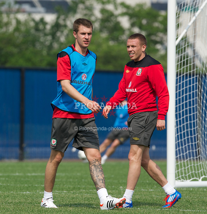 HOKOBEN, NEW JERSEY, USA - Wednesday, May 23, 2012: Wales' captain Aaron Ramsey and Craig Bellamy during a training session at the New York Giants' Timex Performance Centre. The team are in the USA to face Mexico in a friendly match. (Pic by David Rawcliffe/Propaganda)