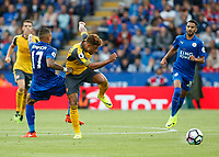 Football - 2016/2017 Premier League - Leicester Ciity V Arsenal. <br /> <br /> Alex Oxlade-Chamberlain of Arsenal rides a challenge from Danny Simpson of Leicester City at The King Power Stadium.<br /> <br /> COLORSPORT/DANIEL BEARHAM