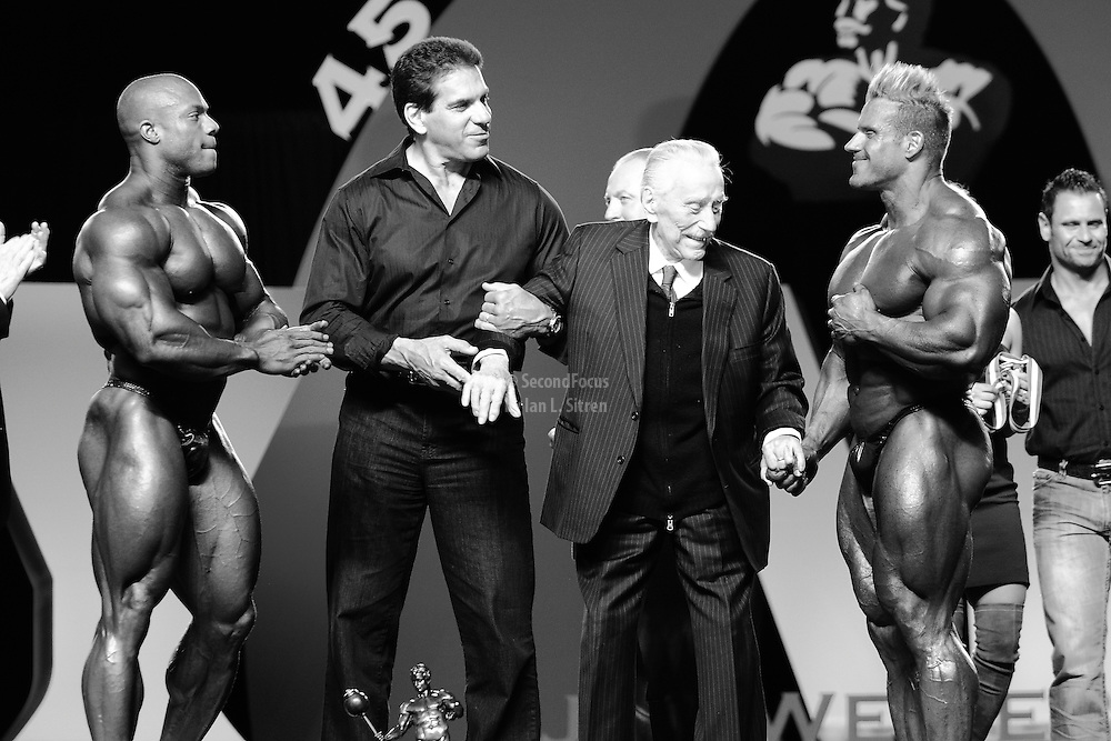 Phil Heath, Lou Ferrigno,  and Joe Weider on stage at the announcement of Jay Cutler as the winner of the 2010 Mr. Olympia in Las Vegas.