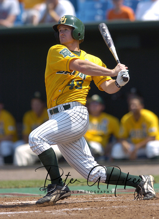 Baylor's Reid Brees hits a two out double in the top of the fifth and later scores too tie the game with Oregon State at two.  Baylor defeated Oregon State 4-3 in ten innings and eliminated OSU from the College World Series at Rosenblatt Stadium in Omaha, Nebraska on June 20, 2005.