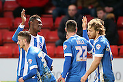 Rohan Ince scores and celebrates with team mates during the Sky Bet Championship match between Charlton Athletic and Brighton and Hove Albion at The Valley, London, England on 10 January 2015.