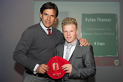 CARDIFF, WALES - Saturday, May 11, 2013: Dylan Thomas is presented with his U16's cap by Wales national team manager Chris Coleman at the FAW Trust Under-16's cap presentation. (Pic by David Rawcliffe/Propaganda)