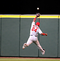 Los Angeles Angels' Gary Matthews Jr. jumps unsuccessfully to catch Seattle Mariners' Adrian Beltre's double to center field in the third inning of MLB action in Seattle on Saturday, April 12, 2008..(AP Photo/Kevin P. Casey)