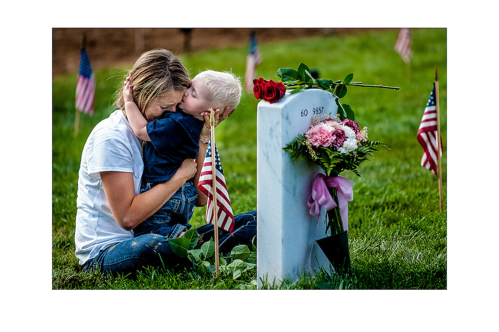 Brittany Jacobs of Hertford, NC, hugs her 17-month old son Christian at her husband, Marine SGT Christopher Jacobs' gravesite in Arlington National Cemetery on Memorial Day in Arlington, VA, USA.<br /> <br /> Date: May 28, 2012.