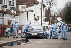 © Licensed to London News Pictures. 03/04/2018. London, UK. Members of a police search team fingertip search the scene on Chalgrove Road, Tottenham, north London where a 17 year old girl was shot dead. The girl was found with a bullet wound and pronounced dead at the scene at 21:43 last night. Photo credit: Ben Cawthra/LNP
