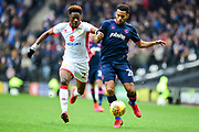 Milton Keynes Dons striker (on loan from Chelsea) Ike Ugbo (27) battles with Portsmouth defender Nathan Thompson (20) during the EFL Sky Bet League 1 match between Milton Keynes Dons and Portsmouth at stadium:mk, Milton Keynes, England on 10 February 2018. Picture by Dennis Goodwin.