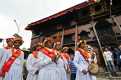 September 15, 2016 - Kathmandu, NE, Nepal - Preist on a traditional attire playing traditional drums attending on the third day of Indra Jatra Festival celebrated at Basantapur Durbar Square, Kathmandu, Nepal on Thursday, September 15, 2016. Devotees celebrated the god of rain 'Indra' for 8 days in Kathmandu. (Credit Image: © Narayan Maharjan/NurPhoto via ZUMA Press)