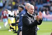 Leeds United manager, Steve Evans  applauding the fans during the Sky Bet Championship match between Burnley and Leeds United at Turf Moor, Burnley, England on 9 April 2016. Photo by Simon Davies.
