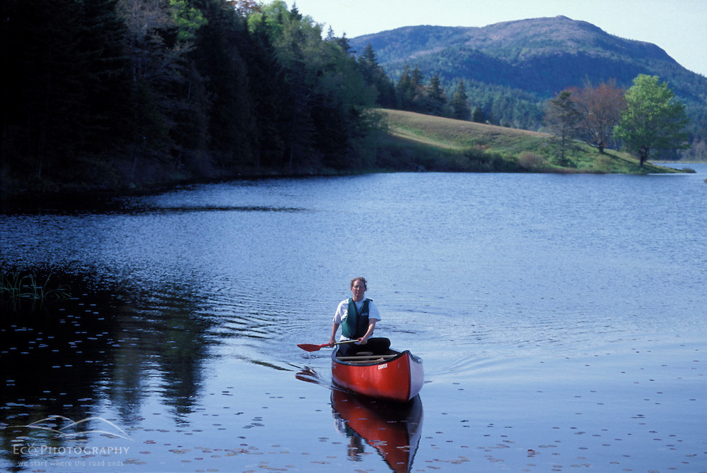 Acadia N.P., ME. Canoeing. Little Long Pond. Parkman Mtn. Spring.