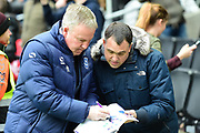 Portsmouth manager Kenny Jackett signs an autograph for a fan during the EFL Sky Bet League 1 match between Milton Keynes Dons and Portsmouth at stadium:mk, Milton Keynes, England on 10 February 2018. Picture by Dennis Goodwin.