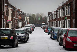 © Licensed to London News Pictures . 09/11/2013 . Manchester , UK . Streets in Salford are covered by a white blanket of freshly fallen hailstones . A freak hail storm in Manchester covers the streets with large hailstones as loud rolling thunder is heard . Photo credit : Joel Goodman/LNP
