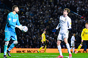 Leeds United forward Patrick Bamford (9) blocks Millwall goalkeeper Bartosz Bialkowski (33) during the EFL Sky Bet Championship match between Leeds United and Millwall at Elland Road, Leeds, England on 28 January 2020.