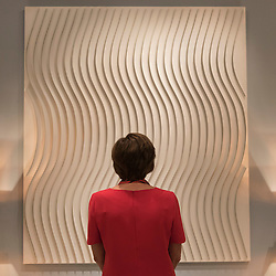 "© Licensed to London News Pictures. 29/06/2016. London, UK.  A woman views ""Sinuzoide"" by Marc Cavell at the preview, in Chelsea, of Masterpiece London, the leading international fair for art and design from antiquity to the present day with works from 154 world-renowned exhibitors on sale.  The fair is open until 6 July.Photo credit : Stephen Chung/LNP"
