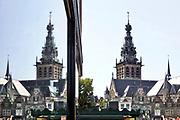 Nederland, Nijmegen, 26-6-2018Het centrum van de stad  met de stevenskerk als landmark . Reflectie in een winkelruit .Foto: Flip Franssen