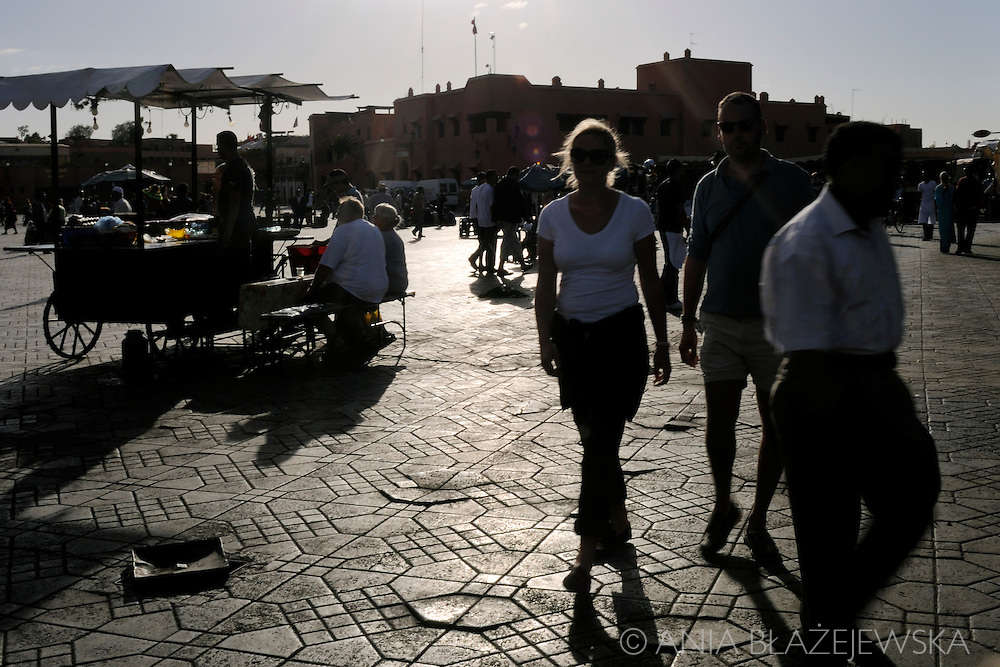 Morocco, Marrakesh. People enjoying the evening at Djemaa el-Fna, the most famous place in Marrakesh.