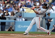 LOS ANGELES, CA - APRIL 6:  Angel Pagan #16 of the San Francisco Giants hits a single in the top of the 3rd inning during the game against the Los Angeles Dodgers at Dodger Stadium on Sunday, April 6, 2014 in Los Angeles, California. The Dodgers won the game 6-2. (Photo by Paul Spinelli/MLB Photos via Getty Images) *** Local Caption *** Angel Pagan