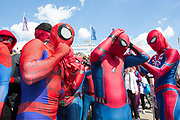 UNITED KINGDOM, London: 25 May 2019 <br /> Cosplay fans dressed as Spider-Man get ready for a picture outside of the London ExCeL during the MCM London Comic Con earlier today. Thousands of cosplay enthusiasts will come to the ExCeL Centre this weekend to enjoy the convention.