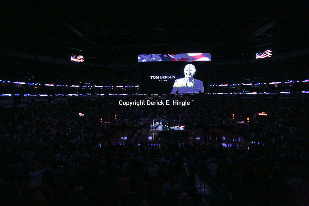 Mar 17, 2018; New Orleans, LA, USA; The video board displays a graphic of Pelicans and New Orleans Saints owner Tom Benson who passed away at the age of 90 years old earlier this week before a game between the New Orleans Pelicans and the Houston Rockets at the Smoothie King Center. Mandatory Credit: Derick E. Hingle-USA TODAY Sports