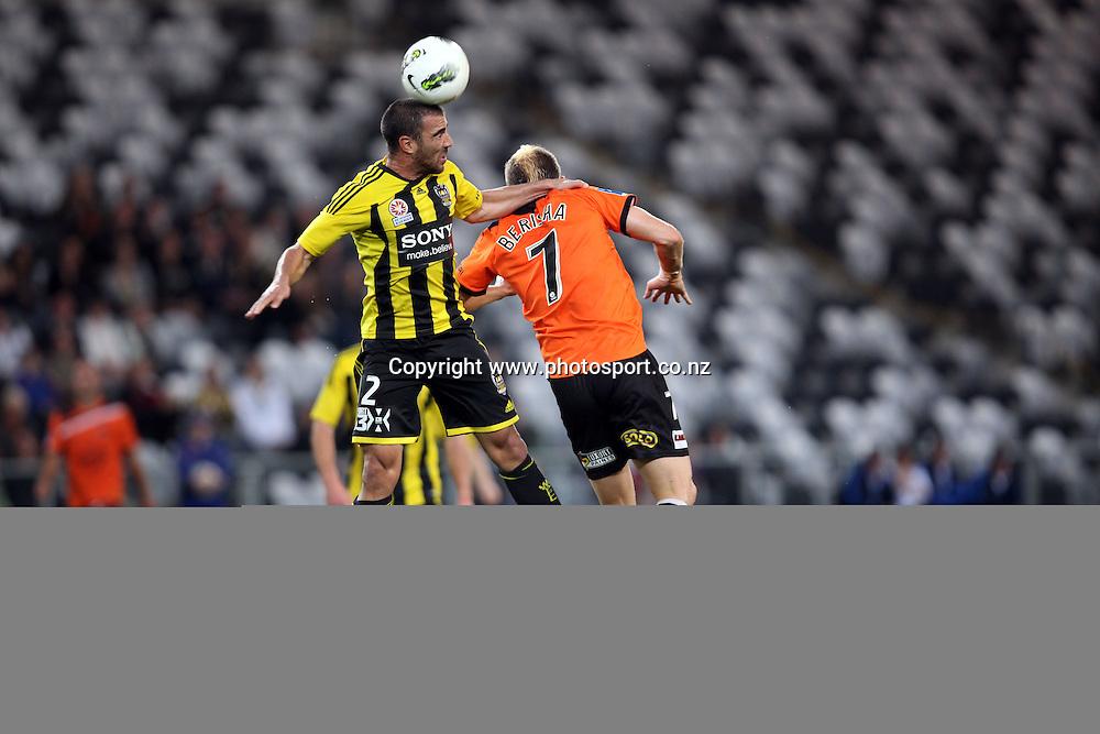 Emmanuel Muscat beats Besart Berisha in the air..<br /> Hyundai A-League - Wellington Phoenix v Brisbane Roar, 14 December 2011, Forsyth Barr Stadium, Dunedin, New Zealand. <br /> Photo: Rob Jefferies/PHOTOSPORT