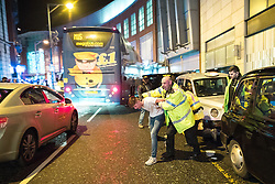 "© Licensed to London News Pictures . 24/12/2016 . Manchester , UK . Police detain a man , following a fight outside The Birdcage on Withy Grove . Revellers out in Manchester City Centre overnight during 2016's second "" Mad Friday "" , named for historically being one of the busiest nights of the year for the emergency services in the UK . Photo credit : Joel Goodman/LNP"